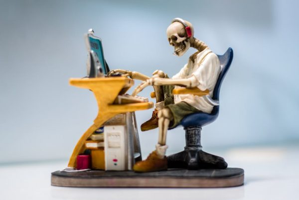 Skeleton on a chair fighting review spam in his financial marketing!