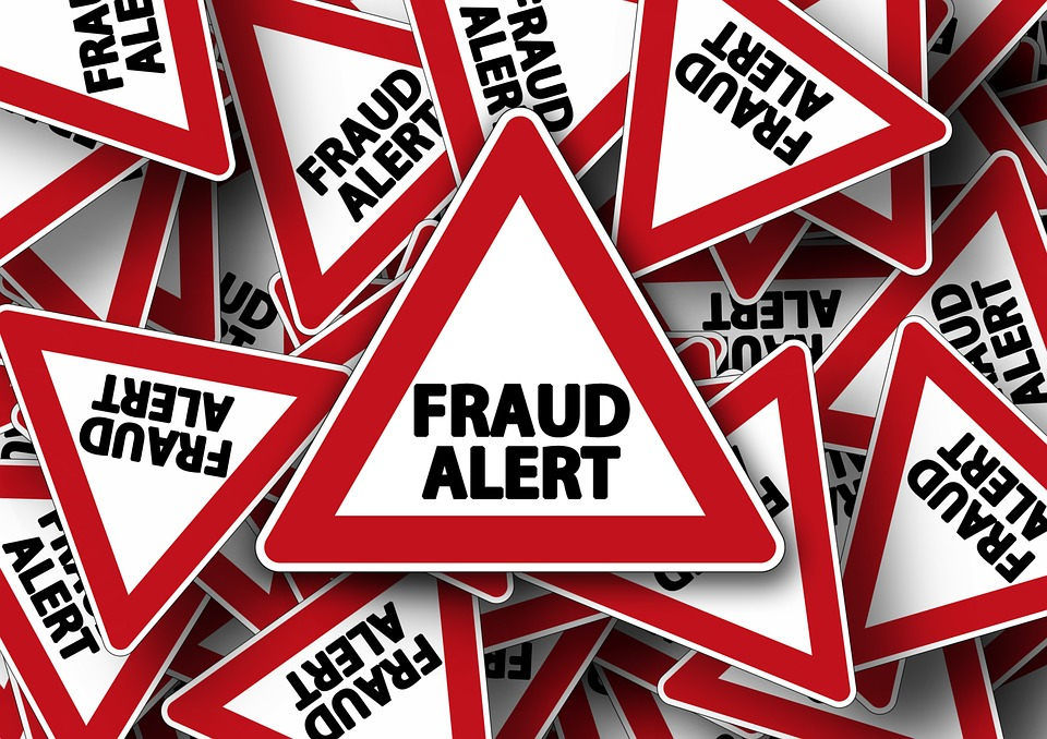 Fraud alert sign in financial marketing