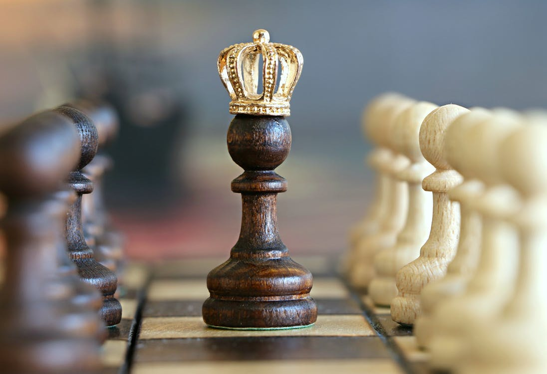 Chess piece with a crown - always survey your competition in finance marketing