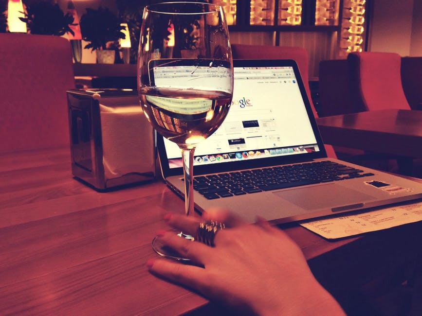google on a laptop, a glass of wine, and a woman doing financial lead generation