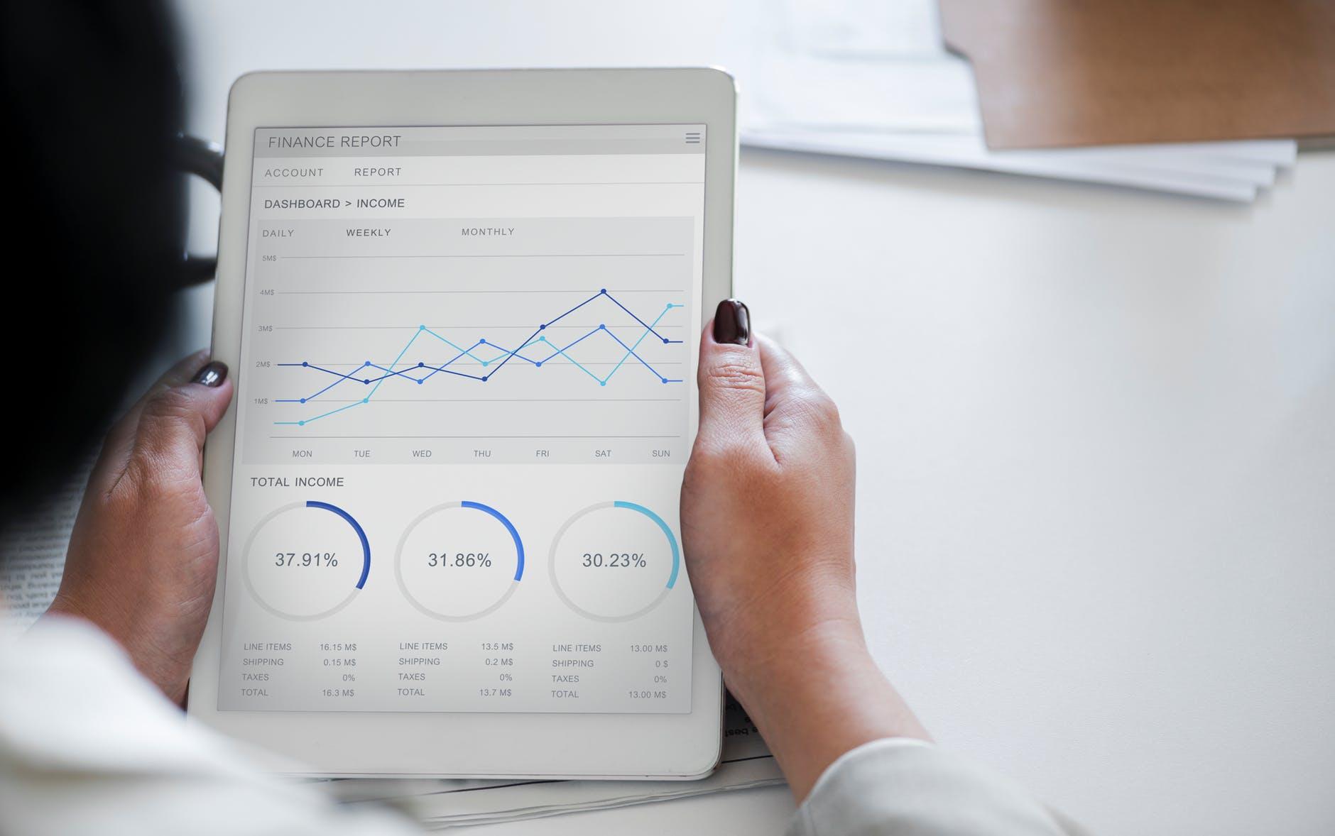 A man looking at his financial marketing agency goals