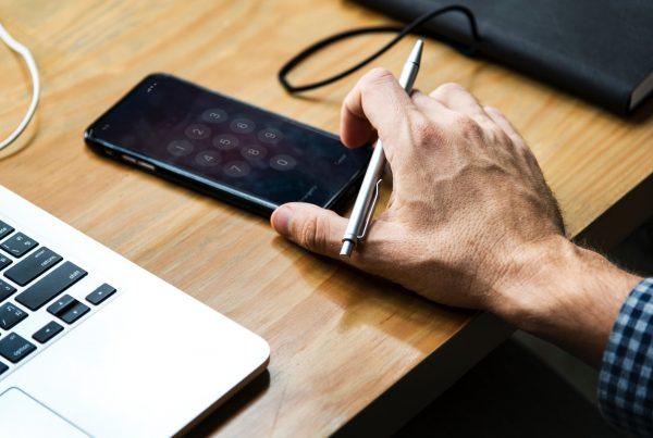 Man using digital marketing for financial advisers on his desktop computer
