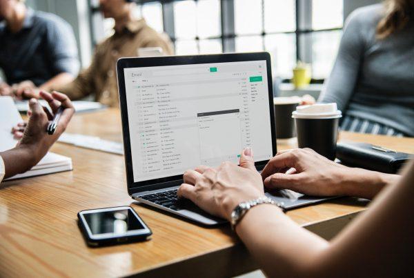 Businesswoman creating a financial newsletter